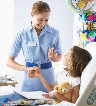 Nurse with girl patient