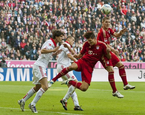 Bayern Munich's striker Mario Gomez (C) heads the ball during the German first division Bundesliga football match FC Bayern Munich vs 1. FC Nuremberg in the southern German city of Munich on October 29, 2011. Bayern