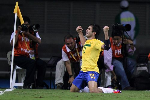 Razil's Henrique (R) celebrates after his second goal against Mexico