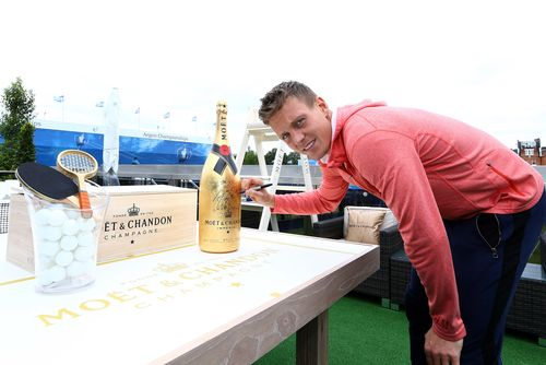 Berdych signs the Moët Methuselah for Rally Against Cancer