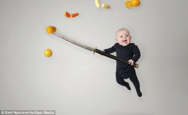 A black babygro and a sword make Signhild into a fruit-slicing ninja