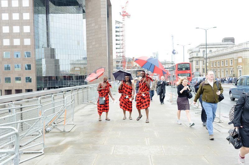 Kenyan Maasai warriors on a rainy London Bridge