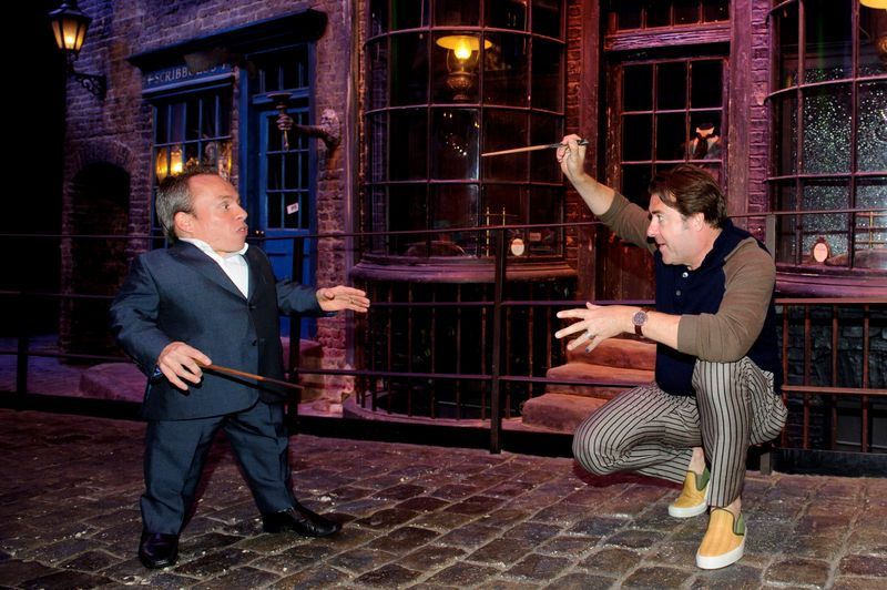 Jonathan Ross and Warwick Davis on Diagon Alley at Warner Bros  Studio Tour Londons Harry Potter Summer Screenings (2) (LRFR)