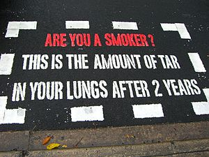English: An anti-smoking message painted on a ...