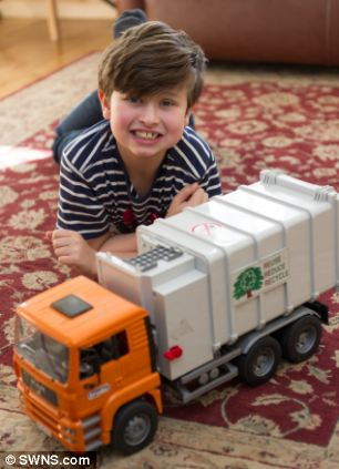 William Bateman, now aged eight, has a huge collection of toy wheelie bins, high-vis jackets and miniature lorries