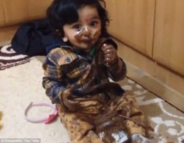Oh no! This little girl sports a look of surprise as she realizes she has been caught red-handed by her parents