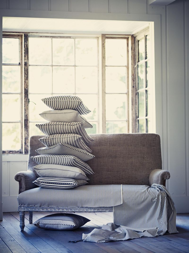 Ian Mankin - Candy Stripe Indigo fabric with Ticking 01 and 02 cushions - lifestyle - Portrait