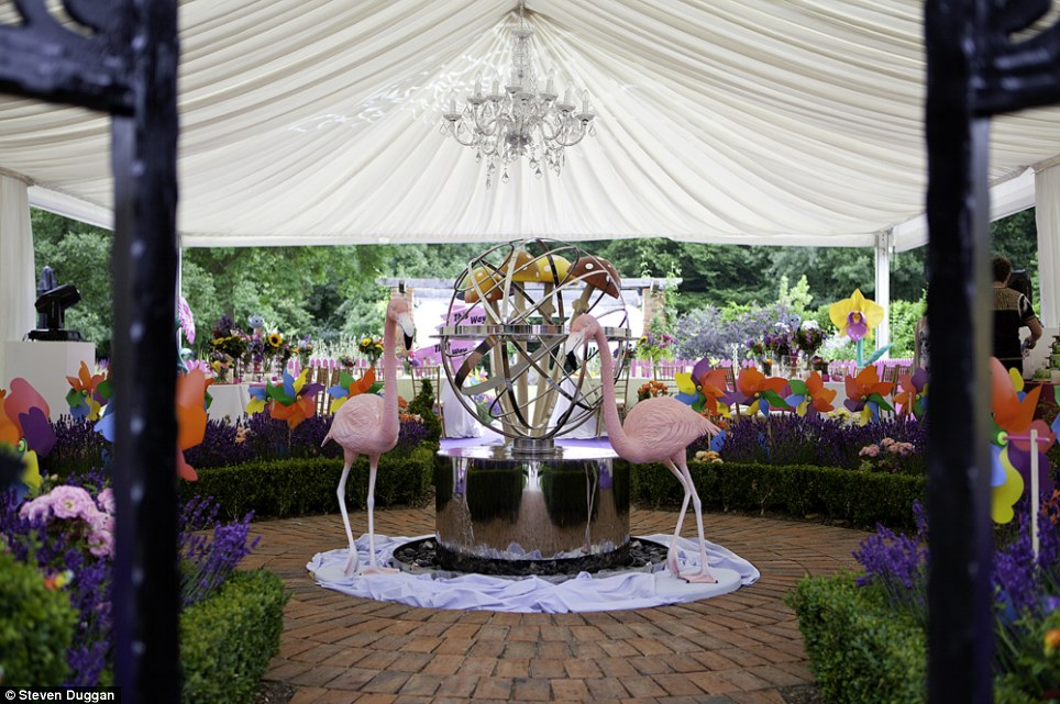The birthday party included elaborate props such as these flamingos (centre) and flowerbeds filled with windmills