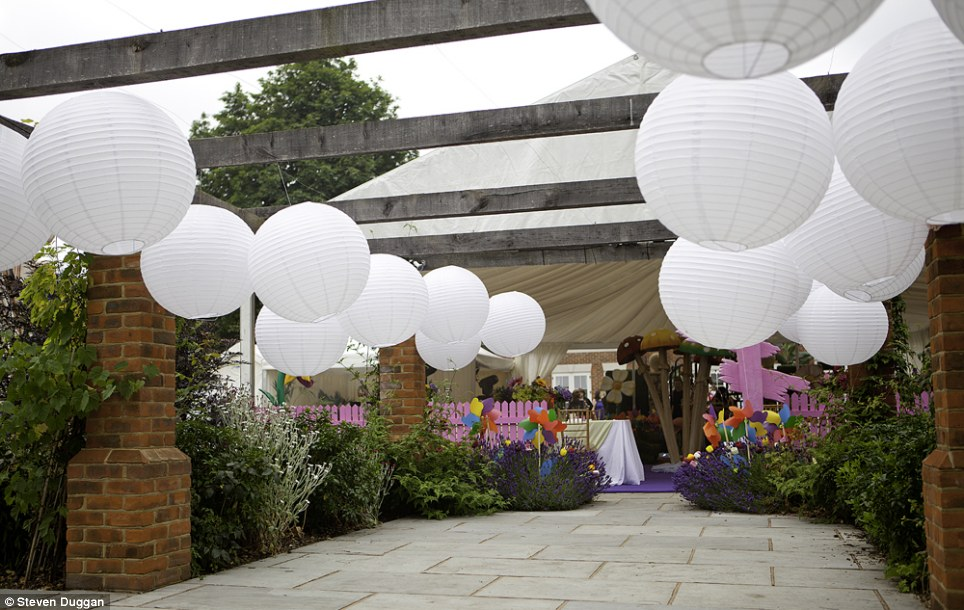Paper lampshades were used to give the outside of the marquee a fantastical appearance with the help of flowerbeds crammed with colourful windmills