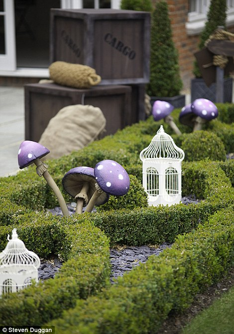 Fairytale: No detail was left out, whether pink Alice in Wonderland style signs or flowerbeds and hedges dotted with purple toadstools