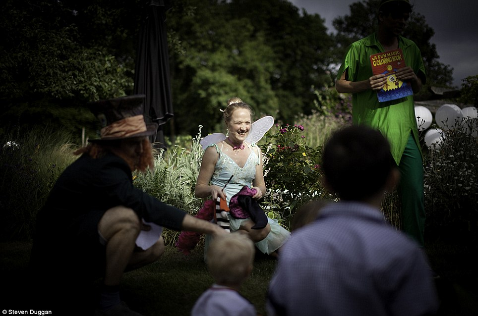 Playtime: Entertainers dressed as Tinkerbell and the Mad Hatter were on hand to amuse the pint-sized partygoers