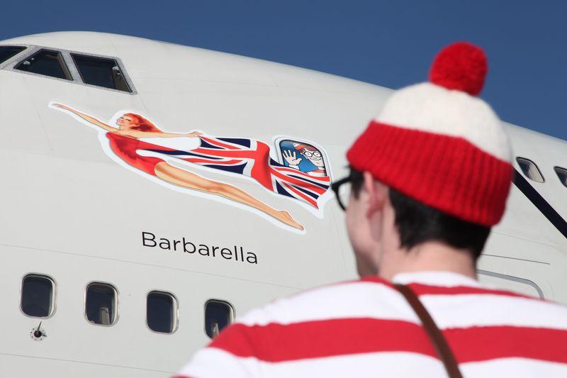 Close up Wally looking at plane