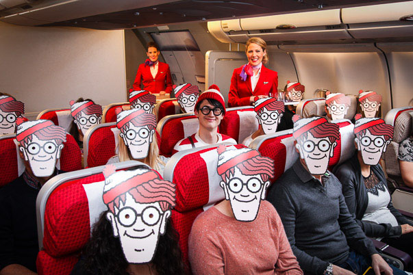 Wally with masked passengers inside plane
