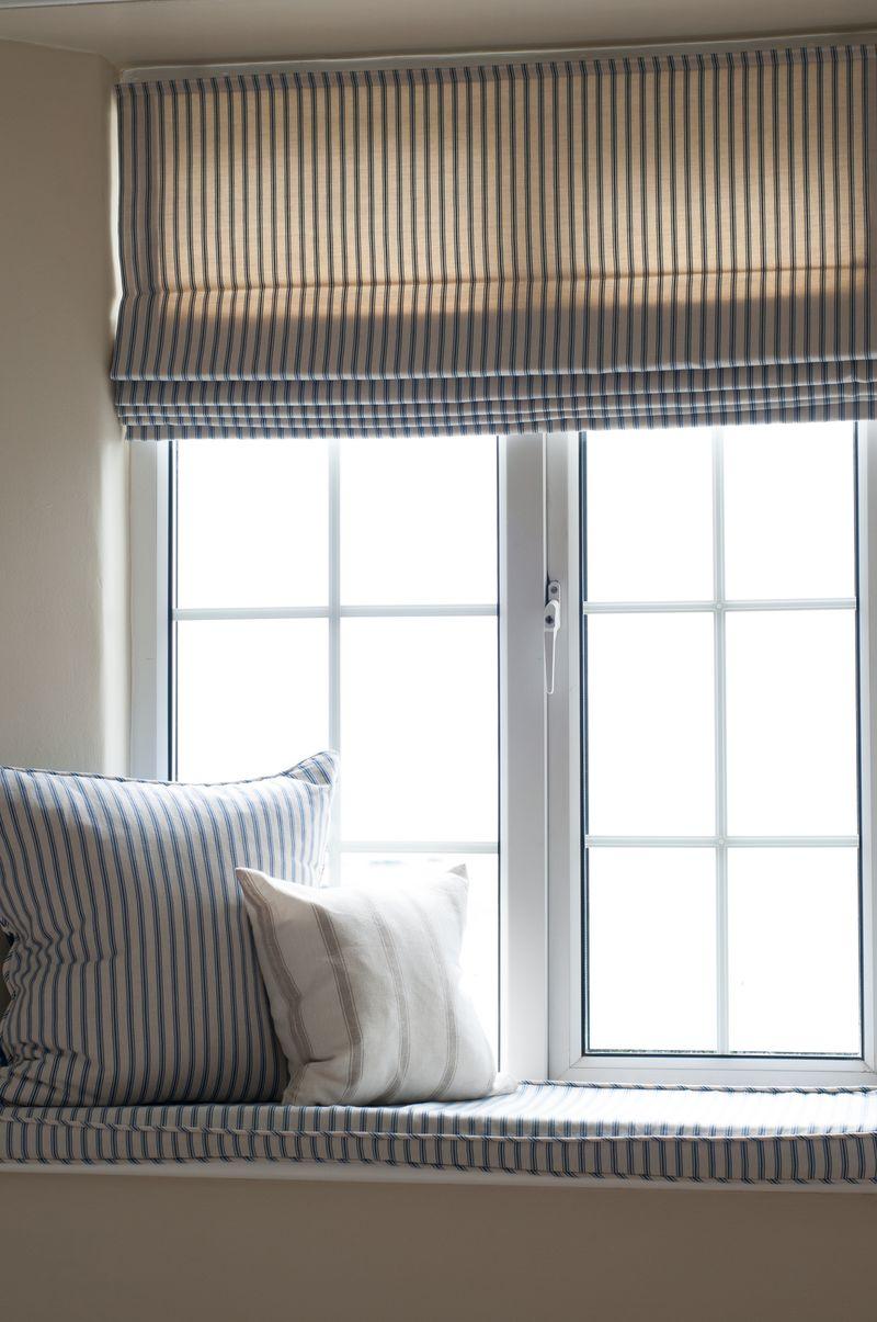 Ian Mankin - Curtain and cushions in window in Ticking 01 Indigo - lifestyle - Portrait