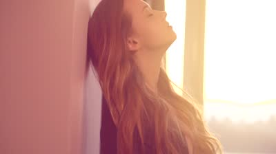 Stock-footage-depressed-girl-at-home-upset-teenager-girl-sad-girl-near-window-sadness-stress-pain-slow