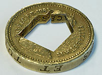 Pound_coin_house